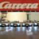 vier Carrera Autos nebeneinander
